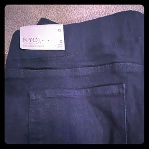 A pair of NYDJ leggings and a long Shirt.